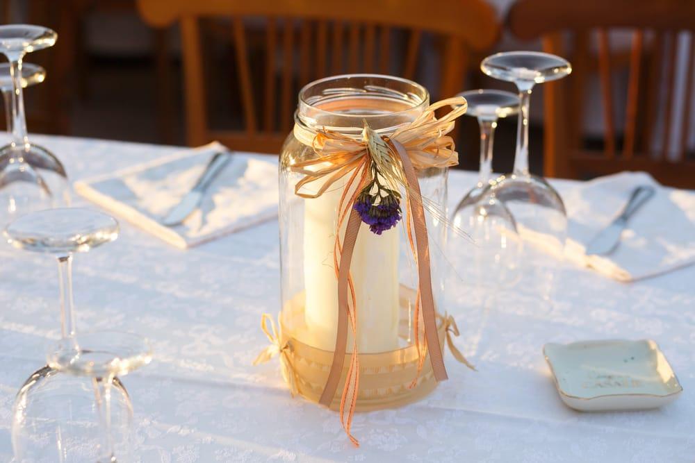 portacandele con bottiglie di vetro