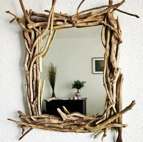 Specchio con cornice di rametti